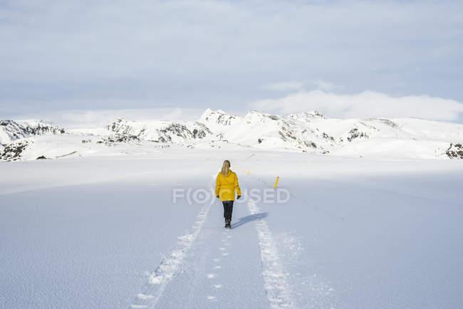 Woman enjoying snow-covered field, Litla-heidi, Iceland — Stock Photo