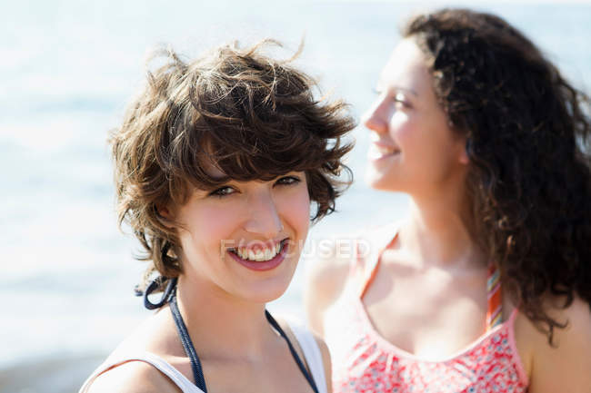 Women smiling together outdoors — Stock Photo