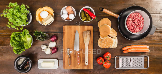 Table laid with ingredients and utensils — Stock Photo