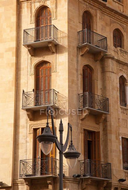 Facade corner of building with balconies — Stock Photo