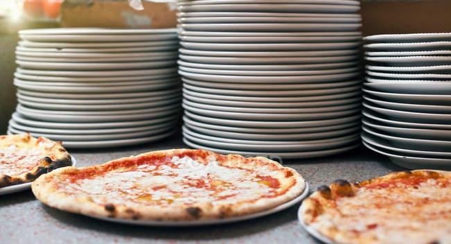 Three pizzas on plates — Stock Photo