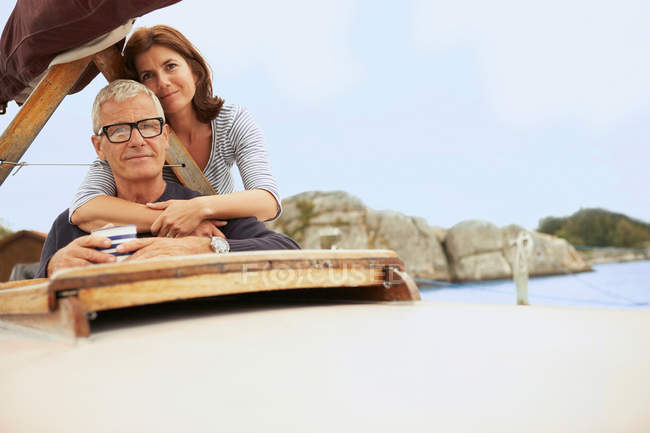 Middle aged couple on old boat — Stock Photo