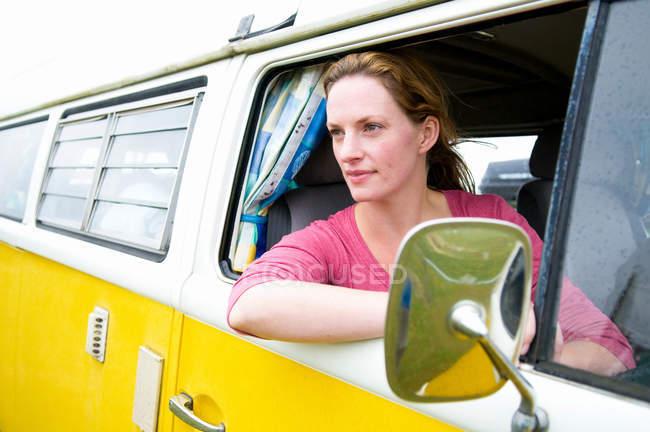 Women looks out of camper van — Stock Photo