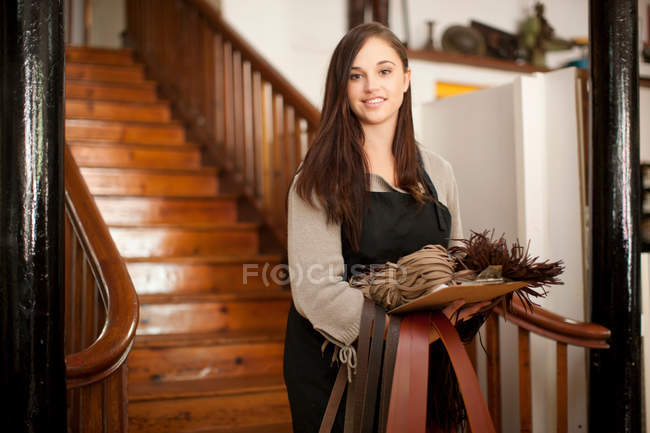Young woman with samples in leather shop — Stock Photo
