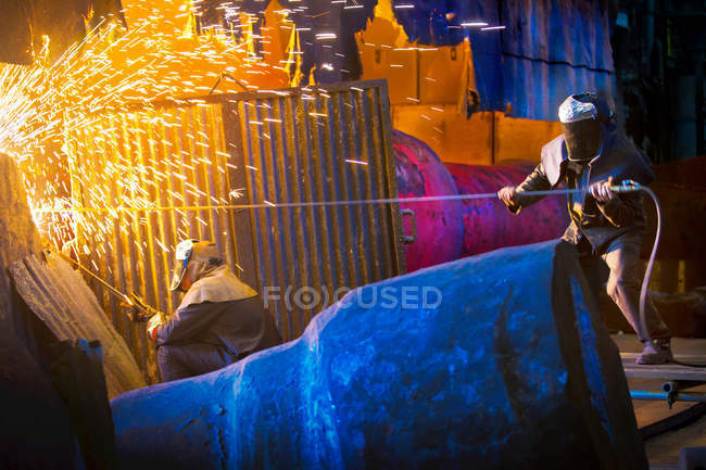 Welders at work in steel forge — Stock Photo