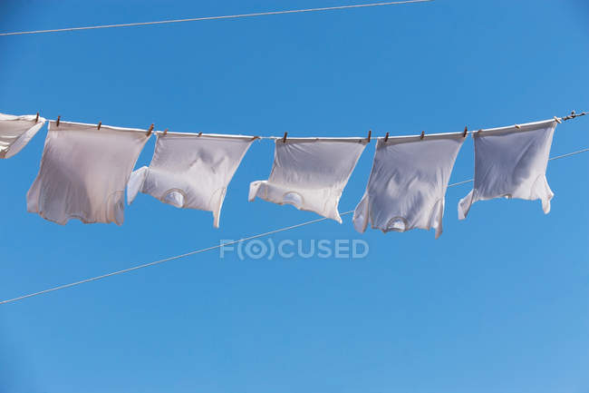 T-shirts waving on clothes line — Stock Photo