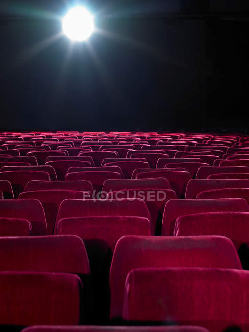 Rows of red cinema seats — Stock Photo