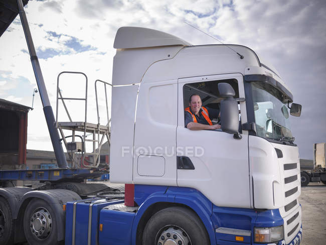 Portrait of smiling truck driver — Stock Photo