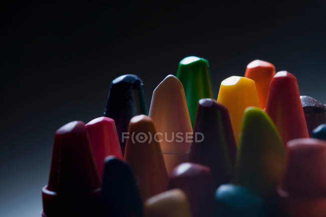 Wax crayons on black — Stock Photo