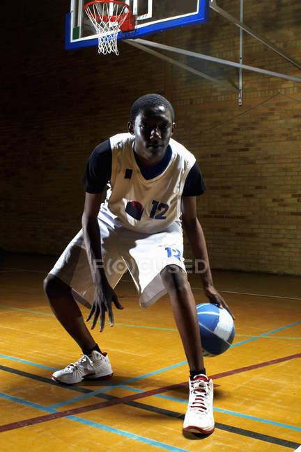 Portrait of basketball player bouncing ball — Stock Photo