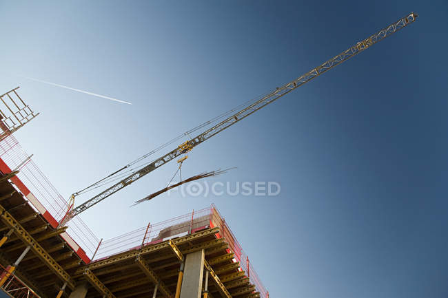 Bottom view of crane on a construction site — Stock Photo