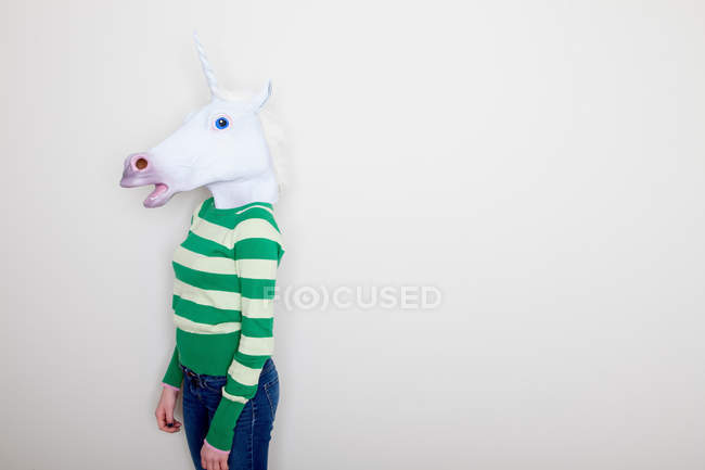 Girl wearing unicorn head mask — Stock Photo