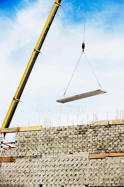Construction crane carry over building materials — Stock Photo