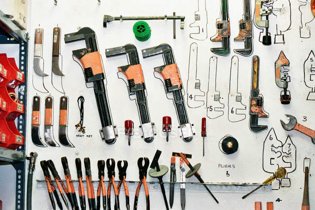 Front view of Tools hanging on wall — Stock Photo