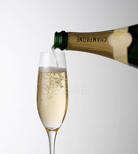 Pouring Champagne into glass — Stock Photo