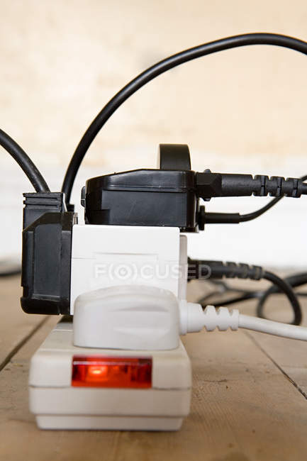 Electrical plugs in multiple socket, close up shot — Stock Photo