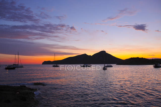 Silhouettes of yachts on sea at sunset, spain — Stock Photo