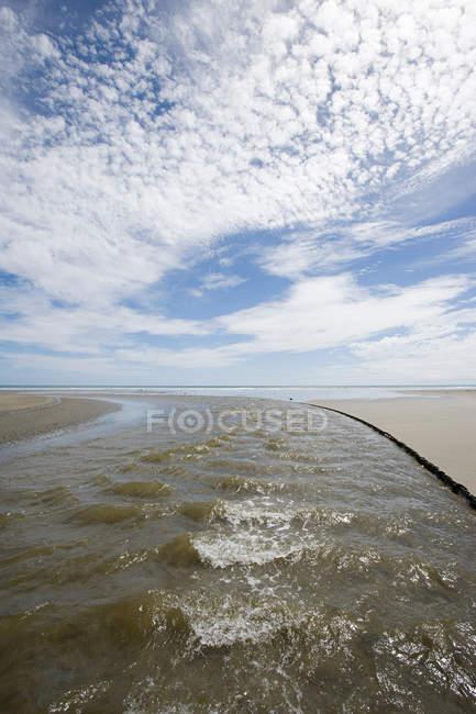 Ahipara Beach with cloudy sky — Stock Photo