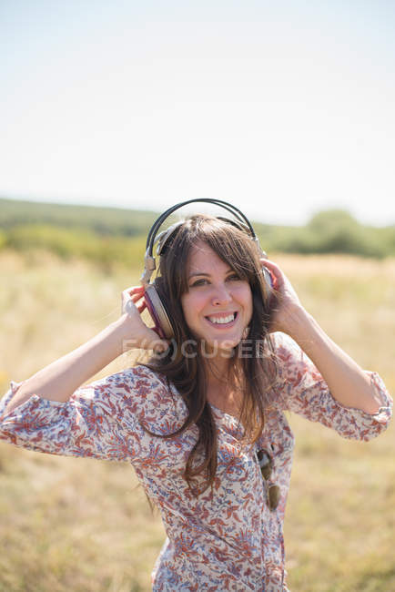Portrait of mid adult woman wearing headphones — Stock Photo