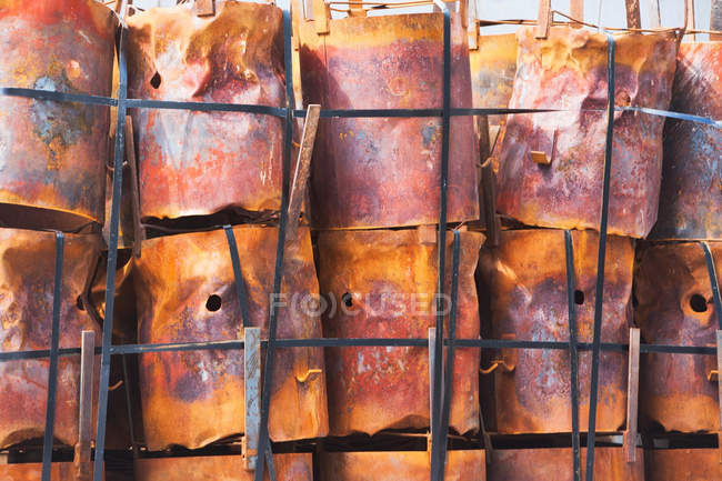Stacked rusting barrels — Stock Photo
