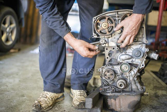 Mechanic working on car part — Stock Photo