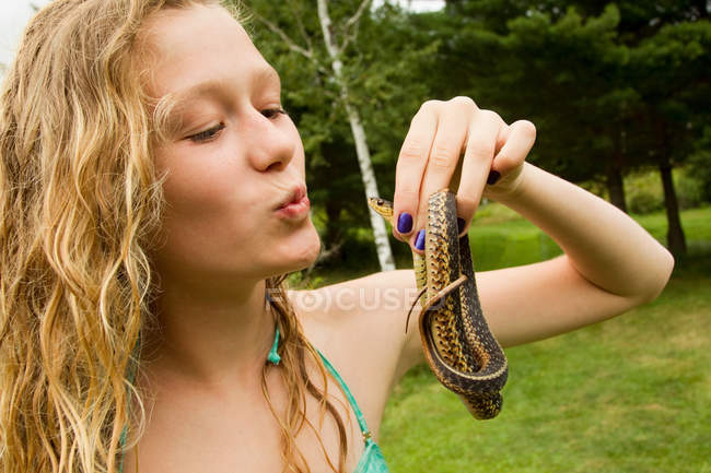 Teenage girl holding small snake — Stock Photo