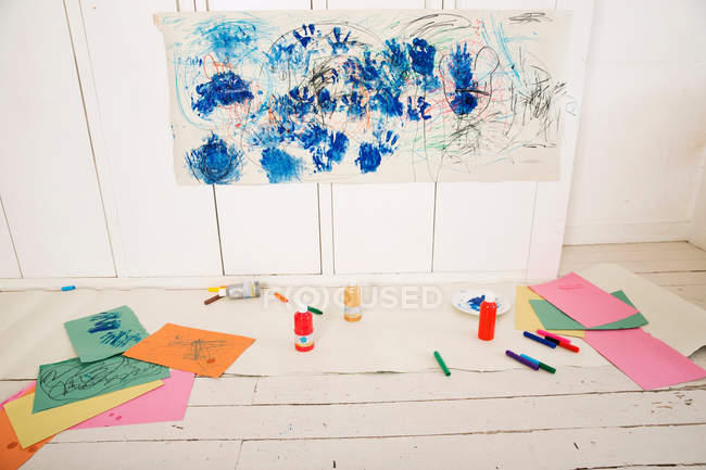 Empty playroom with child hand paintings on wall — Stock Photo