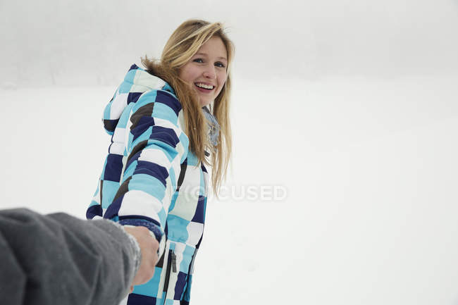 Young woman enjoying snow, Sattelbergalm, Tirol, Austria — Stock Photo
