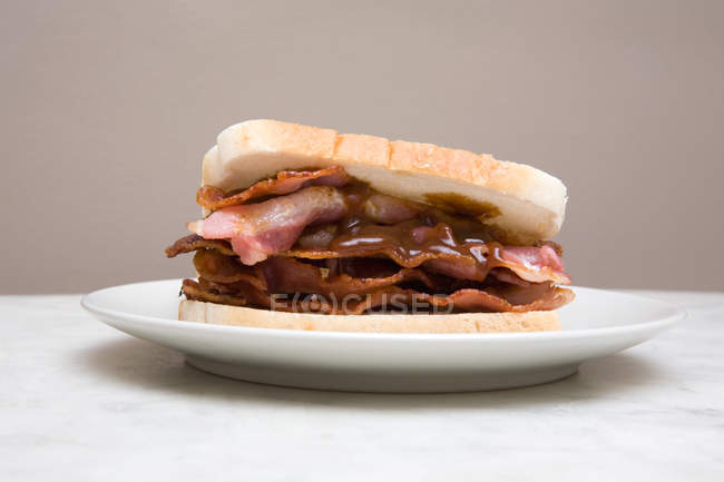 Bacon sandwich on plate — Stock Photo