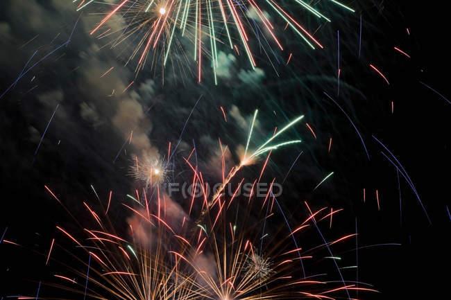 Fireworks exploding in night — Stock Photo