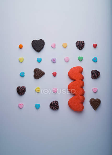 Heart shaped candies isolated on white — Stock Photo