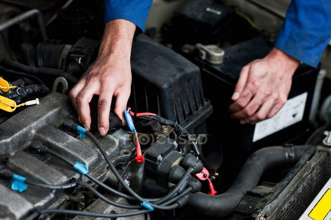 Cropped image of Mechanic fixing car engine — Stock Photo