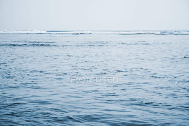 View of pacific ocean and blue background — Stock Photo