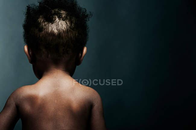 Portrait of baby boy, rear view — Stock Photo
