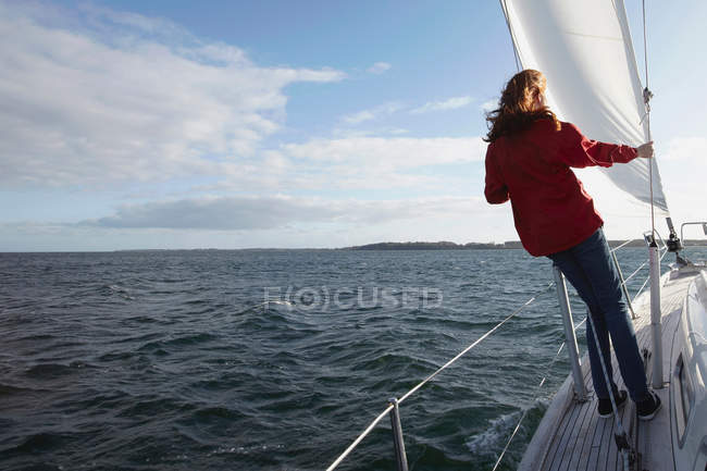 Woman sailing on yacht, rear view — Stock Photo