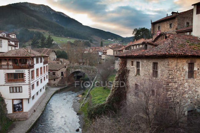 Rural village buildings and canal — Stock Photo