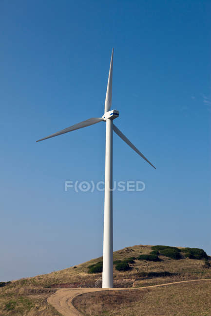 Windmill on rural dirt path — Stock Photo