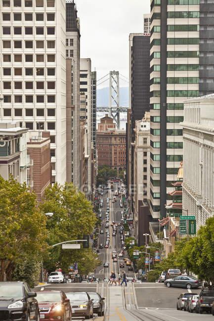 City street and Bay Bridge, San Francisco, California, USA — Stock Photo