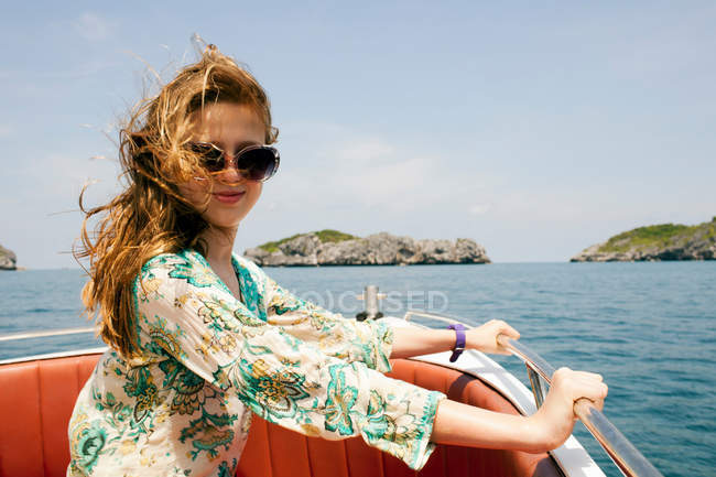 Smiling woman riding on boat — Stock Photo