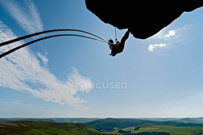 Rock climber scaling rock formation — Stock Photo