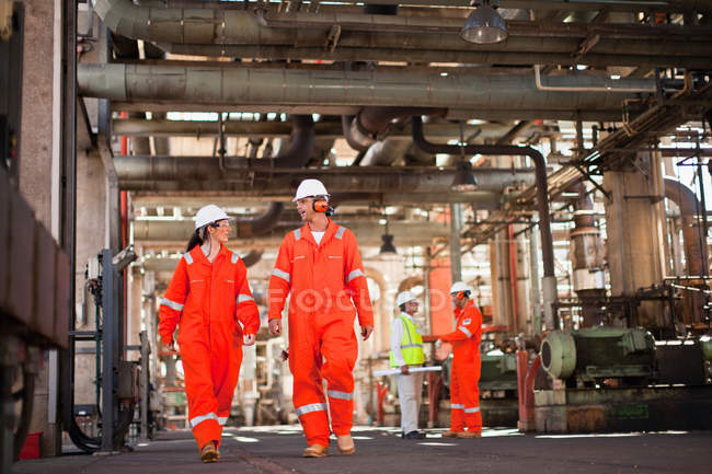Workers walking at oil refinery, selective focus — Stock Photo