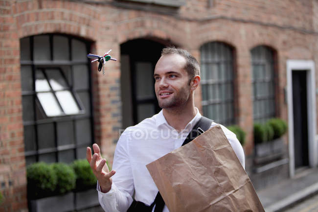 Businessman tossing keys in air — Stock Photo