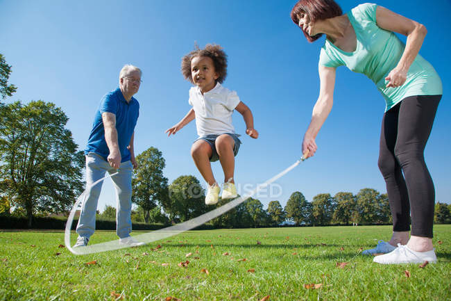 Older couple playing with granddaughter — Stock Photo