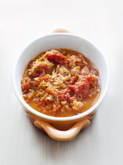 Tasty tomato sauce in bowl on table — Stock Photo