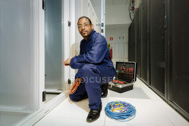 Technician working in server room — Stock Photo