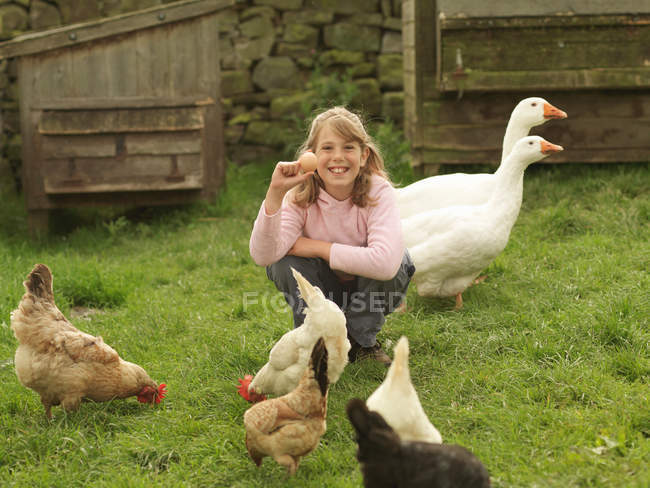 Girl Holding Egg With Hens And Geese — Stock Photo