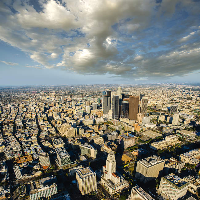 Aerial view of city skyscrapers in bright sunlight — Stock Photo