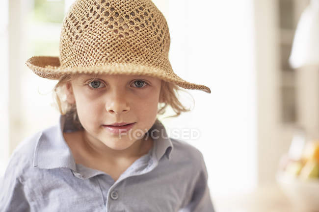 Portrait of boy wearing straw hat, looking at camera — Stock Photo