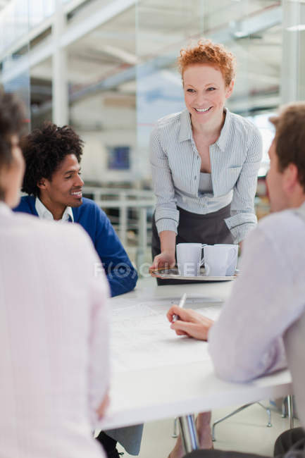 Businesswoman with tray of coffee — Stock Photo