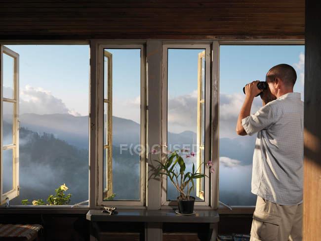 Man & Binoculars Inspecting Plantation — Stock Photo